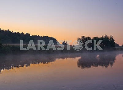 Foggy sunrise on a river