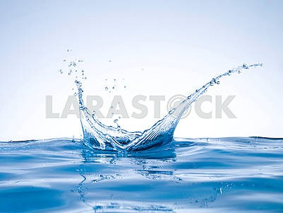 Blue water splash crown shape on water surface isolated on white