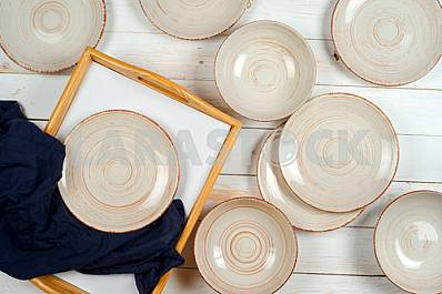 Blank white dish on a wood background.