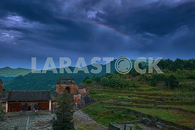 Rainbow over the ancient kung fu temple on the top of mountain.