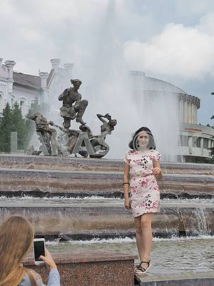 Girls are photographed in a fountain