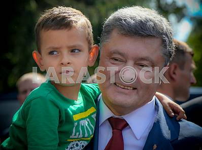 President Petro Poroshenko with the boy in her arms