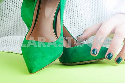 girl holding a high heel shoe in her hand