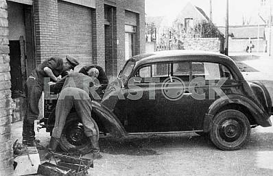German soldiers repairing a car