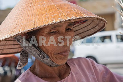 Grandmother wearing a straw hat