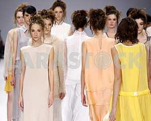 The model demonstrates outfit by Ukrainian designers VOROZHBYT&ZEMSKOVA