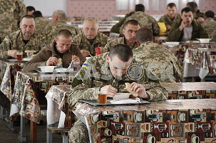 Eating in a soldier's canteen