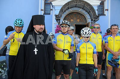 Participants of the bike ride and the priest