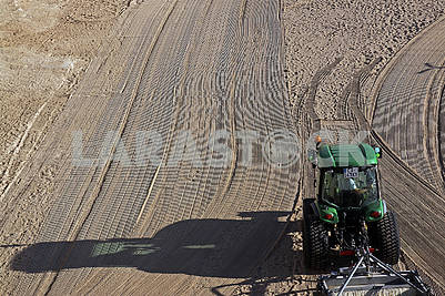Cleaned by a tractor sand on the Mediterranean beach