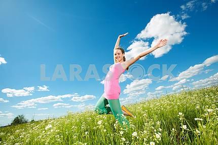 Pretty girl having fun in the field