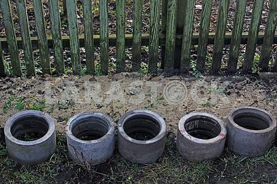 Four concrete drainage pipes