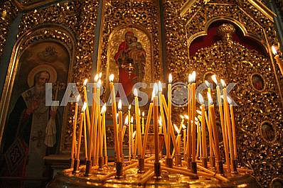 Candles near the icon inside the Assumption Cathedral