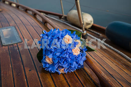 Wedding bouquet on a wooden yacht board
