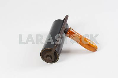 Different construction tools on a wooden background - screwdriver, caliper.