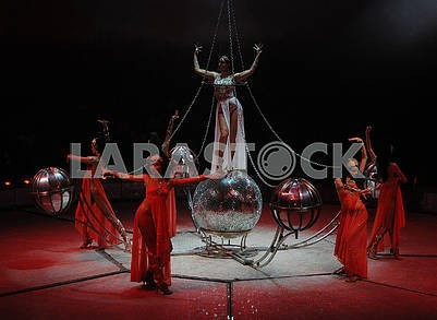 "Circus number ""Hula-hoops on a mirror ball"""