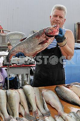 "A man sells fish in the market bringing ""Privoz"" July 5, 2012"