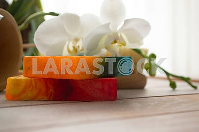 Piece of natural organic soap with herbs and flowers.