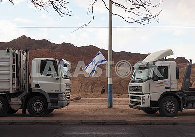 Two trucks and the flag of Israel