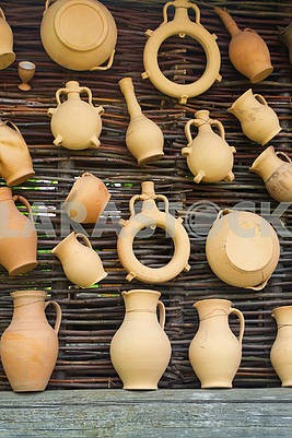 Rustic handmade ceramic clay brown terracotta cups and jug souvenirs collection