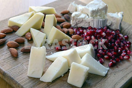 Set of goat cheese on a wooden board