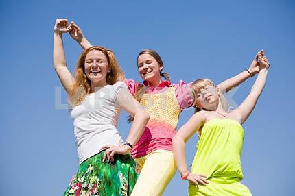 Happy Mother and two daughter jumping