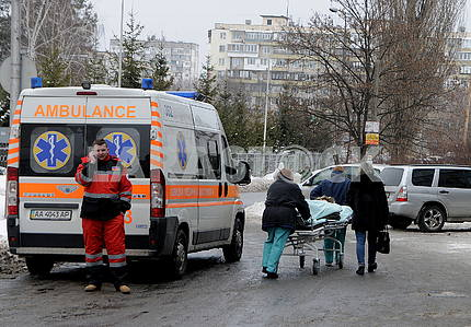 Health workers transport the patient