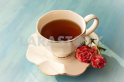 Afternoon tea in white classic with roses on blue wooden table