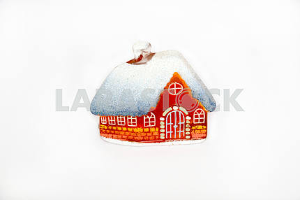 Christmas little glass house with snow covered roof.