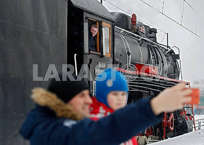 Selfie on the background of the locomotive