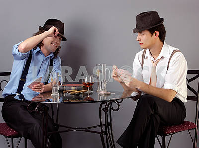 Two men play preference