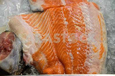 Juicy piece of trout fish on the table.