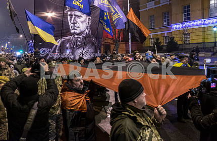 UPA flag and a portrait of Shukhevych