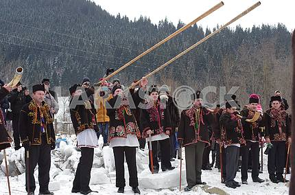 A group of Hutsuls with trembits, barts, horns on the background of the Carpathians on the Feast of Epiphany in Kryvorivn.
