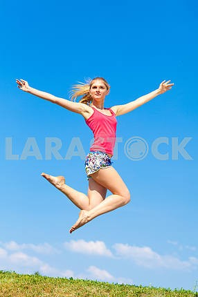 Beautiful young girl jumping