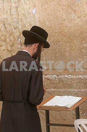 Orthodox man prayers at Western wall of Jerusalem
