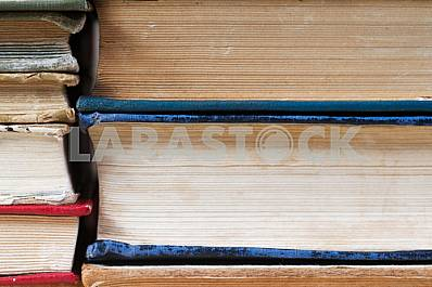 Stack of hardback books on wooden table. Back to school. Copy space