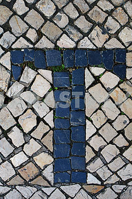 Portuguese sidewalk of calcada in the form of the letter T. Lisbon