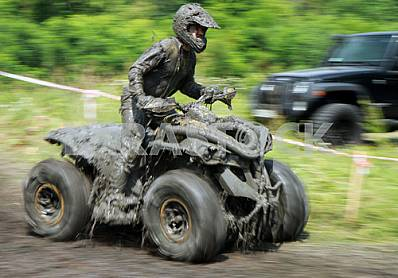 The athlete runs the distance in the competition ATV on hard enduro July 27, 2013