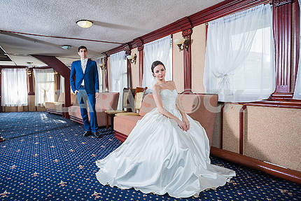 Lovely wedding couple. the bride in a white wedding dress smiling happily. groom in a blue costume.  couple in love