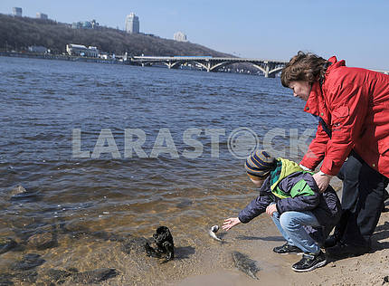 The boy releases fish in the Dnieper