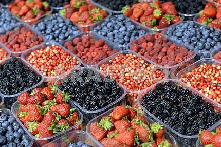 Ripe berries in a plastic containe