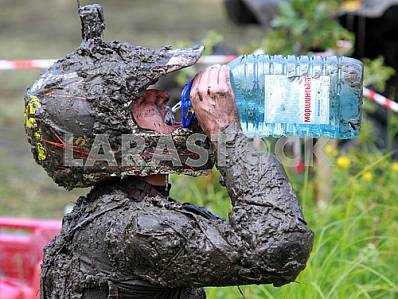 An athlete drinking water after passing the distance in the competition for kvadrotsiklov27 July 2013