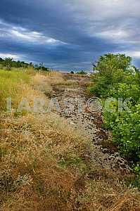 Granite dorozhka.Urochische cascades in summer against a blue sky