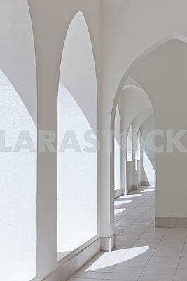 empty abstract light interior corridor background with arches an