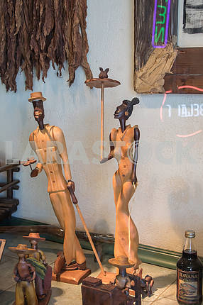 The wooden statues of tobacco products in the store. Miami
