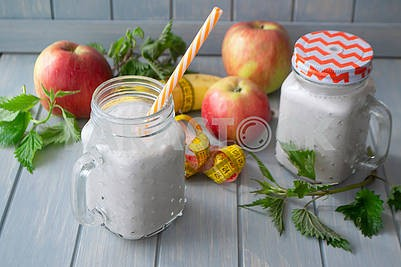 Healthy organic smoothie with apples, bananas and nettle