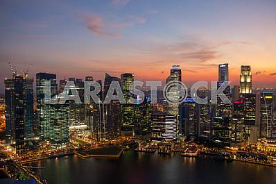 Singapore skyscrapers at sunset.