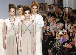 Spectators look at the models that demonstrate outfits Ukrainian designer Tatyana and Alyona Zemskova Vorozhbit
