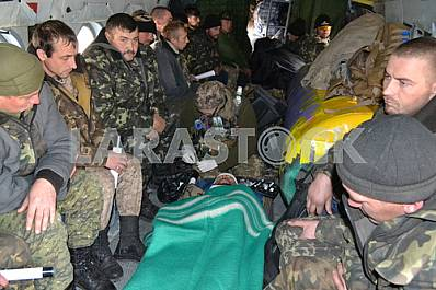 The evacuation of the wounded by helicopter Mi-8