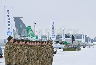 Military personnel and airplanes at a military airfield